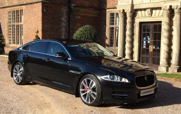 Luxury Black Executive Jaguar XJ Long Portfolio With Privacy Glass