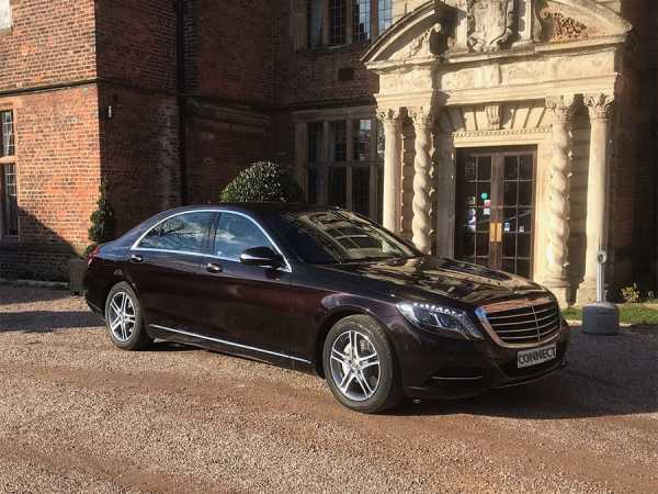The Luxury Mercedes S Class Limo in Ruby Black